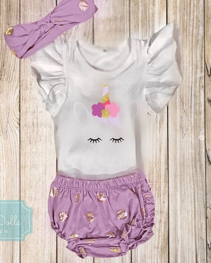 Ruffle sleeve onesie with unicorn design. Complete with lavenger and gold bloomers and matching headband.