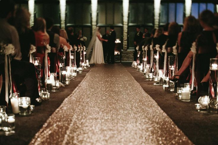 Dress up a seriously glamorous wedding venue with a sequin aisle runner. This beautiful aisle runner will sparkle under the lights during your ceremony and will add an extra dose of glitz to the proceedings. If you're looking for lots of glitter wedding ideas, we've got you covered.