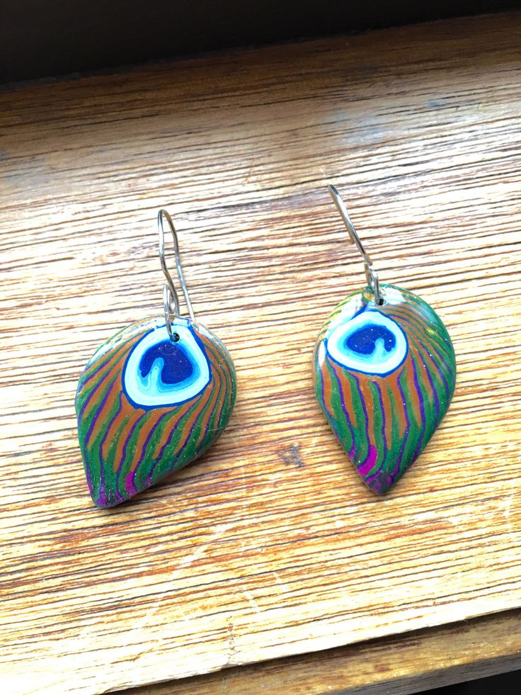 A personal favourite from my Etsy shop https://www.etsy.com/au/listing/507050878/peacock-feather-design-earrings
