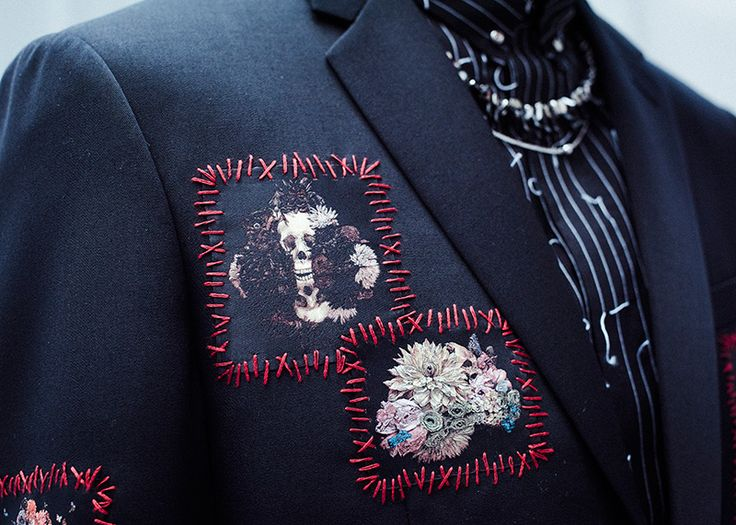The decorative stitching/embroidery on this males jacket would be an example of texture.