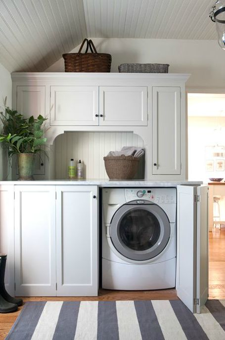 Folding doors, folding cabinet doors, hidden washer and dryer, beadboard