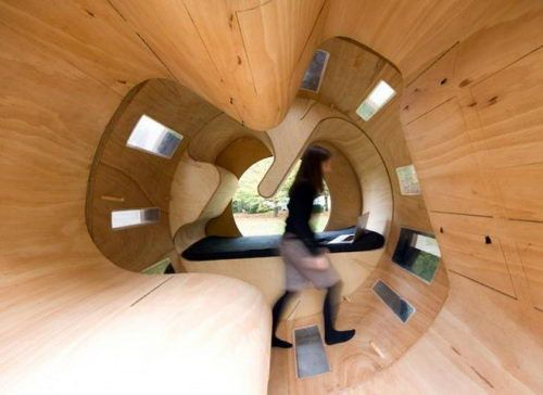 Roll It, a cool experimental house, resulted from the collaboration among different institutes within the University of Karlsruhe. This cyclindrical design is a modular prototype that provides flexible space within a minimum housing unit. Three different sections are dedicated to different functional needs: there's a bed and table in section, an exercise cylinder, and a kitchen with a sink.