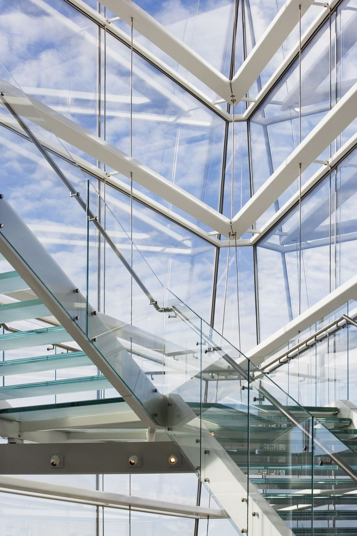 A multiple level glass staircase is comprised of architectural steelwork and uses cast glass for the treads and landings. The balustrade is of cantilevered point supported glass and brushed stainless steel handrails complete the dramatic landmark feature. The stair is wrapped by a wedge shaped atrium of highly transparent structural glazing with limited structure.