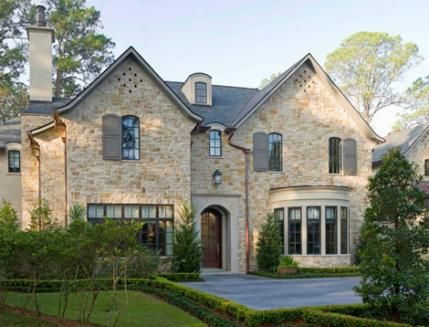 This English-style country home is located near Houston.  - Traditional Home ®/ Photo: John Granen