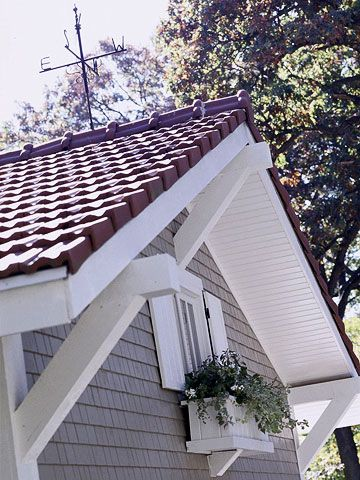 Clay roofing tiles, salvaged from an old church, weigh seven pounds a piece and put the crowning touch on the garage. A custom-made cedar window box fits below the window looking into the garage loft./