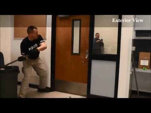 Police Officer Testing Classroom Door Security Device To