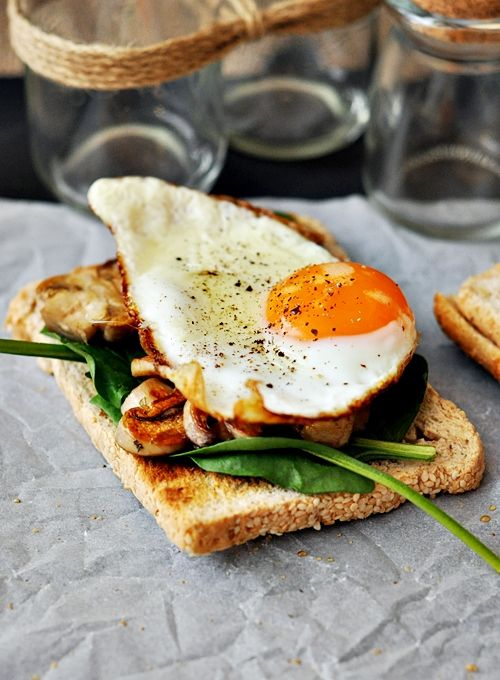 Sauteed mushrooms with dried herbs and garlic + baby spinach leaves + sunny side up egg