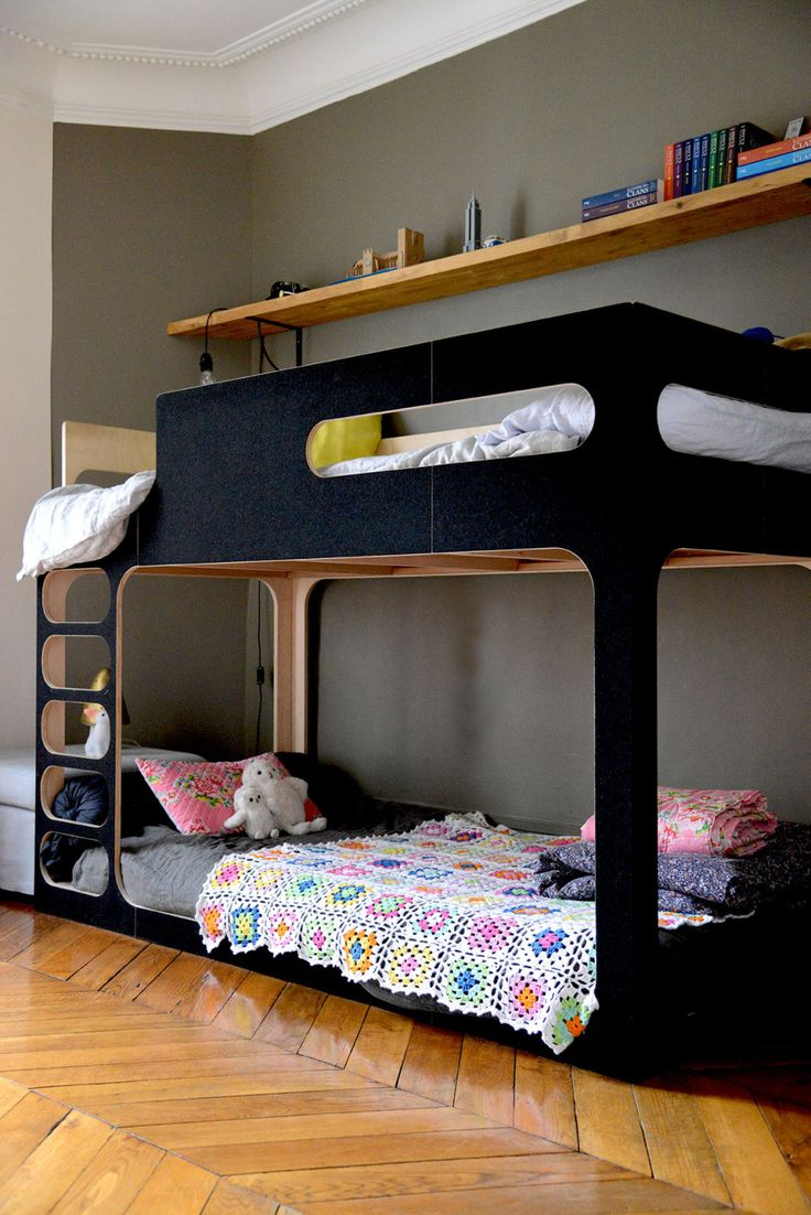 best  black bunk beds ideas on pinterest  loft bed decorating  - a matt black bunk bed makes smart choice for a shared space with thegirl's lower bed decorated with toys and a crochet quilt while the boy'supper bunk