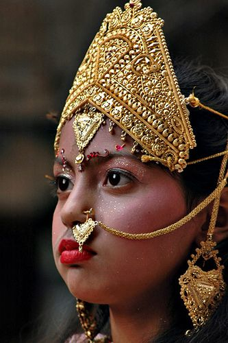 Young girl dressed as a deity as part of a procession to celebrate Lord Krishna's birthday, Amritsar, India