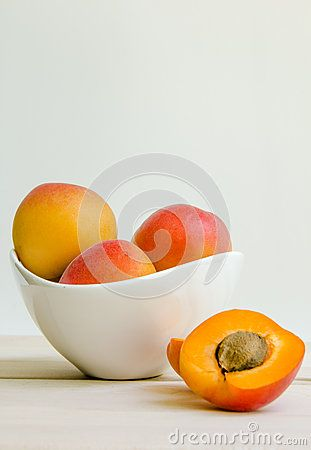 Fresh apricots in white background.