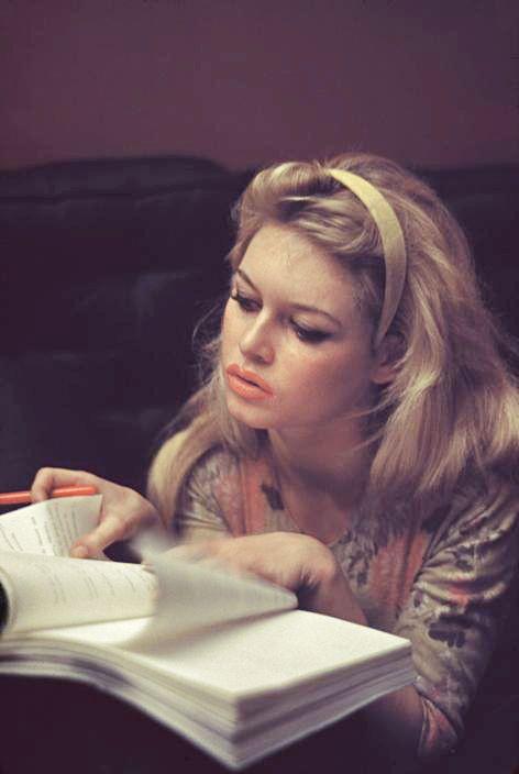 Brigitte Bardot reading, 1958, St. Tropez. Burt Glinn (American, 1925-2008). Glinn worked