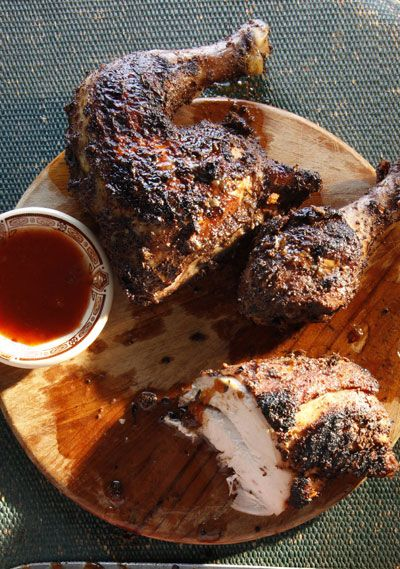 Jamaican Jerk Chicken | Full of fiery chiles and warm spices, the all-purpose Jamaican seasoning for this dish can be used as a rub on pork, goat, fish, and vegetables, as well as chicken. This recipe first appeared in the 2012 SAVEUR 100, with the article Jerk Chicken. | From: saveur.com