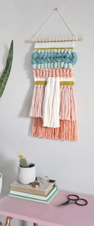 So much texture in this lovely wall hanging, made with a simple tapestry loom and gorgeous, luxe fibers. Want to make your own? You won't believe how easy!