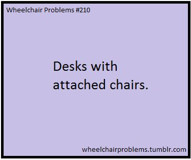 Desks with attached chairs.