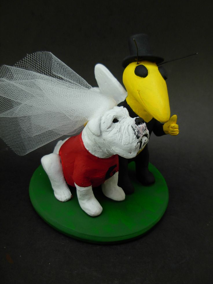Custom made to order Buzz and Bulldog college mascot wedding cake toppers. $235 www.magicmud.com 1 800 231 9814 magicmud@magicmud... blog.magicmud.com twitter.com/... $235 #mascot #collegemascot #hokie #ms.wuf #gators #virginiatech #football mascot #wedding #toppers #custom #Groom #bride #weddingcaketoppers #caketoppers www.facebook.com/... www.tumblr.com/... instagram.com/... magicmud.com/Wedding photos.htm