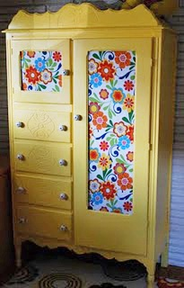 painted chiffarobe/armoire.  Have one very similar to this... love the yellow. Not the fabric. Thinking chicken wire and shelving.