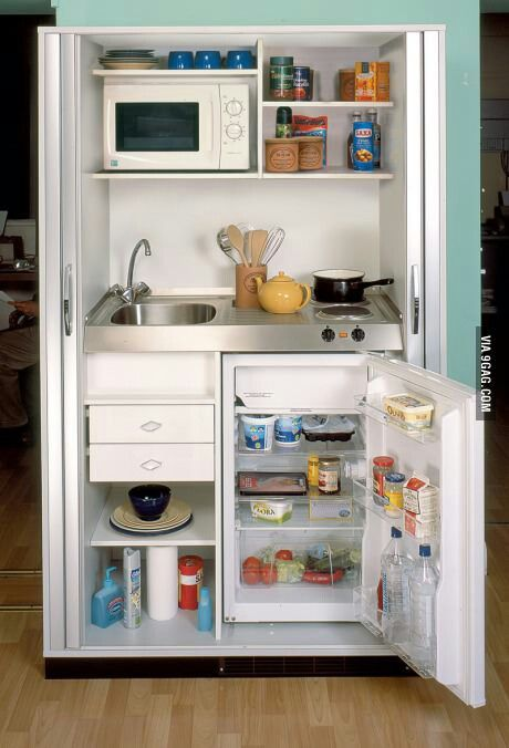 What a clever set up to keep all of your cooking needs in one spot in your tiny house. Very efficient!