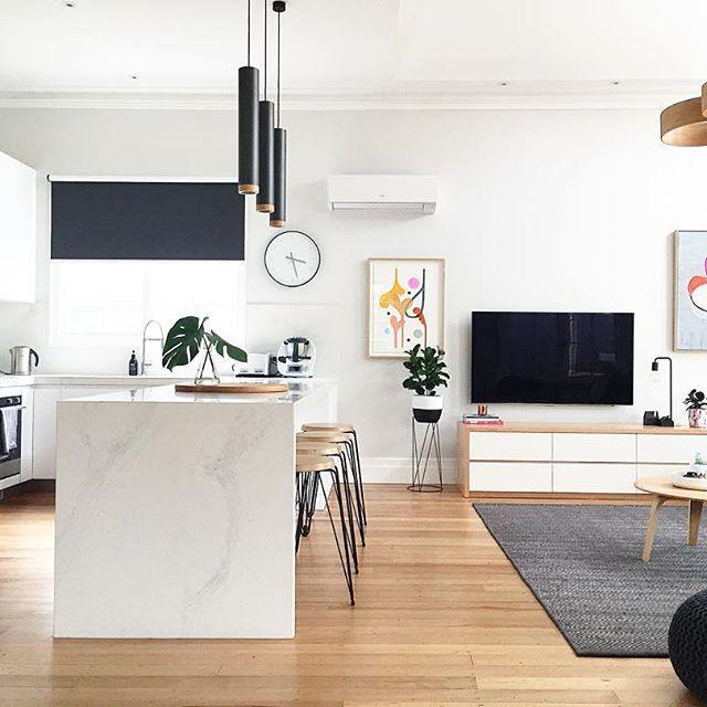 Oak floors, white stone waterfall benchtops, love the artwork and tv cabinet. (via Instagram @meldzam)