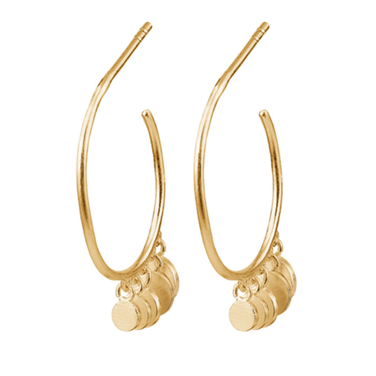 Pernille Corydon Gold Mini Coin Creole Earrings: Soft round miniature coins hanging from a delicately curved gold hoop, these earrings are by contemporary Danish jewellery designer Pernille Corydon. Matching necklace also available.