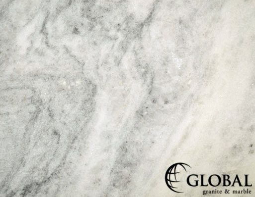 Smoke Polished Granite Slab White background with thin black and grey veining typically in a wave pattern.