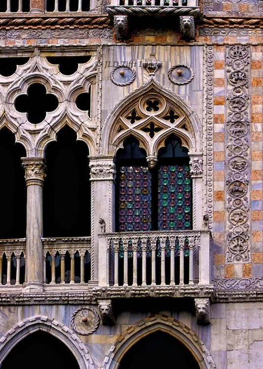Venice, Ca d'Oro, facade detail of its exquisite Gothic ornament. Multicolored marbles, carved figures and corbels, rope, foliated scrolls, pointed arches, quatrefoils, bull's eye glass, etc.