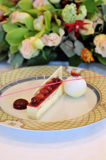 fraises atop mascarpone and a coconut meringe crust; white ...