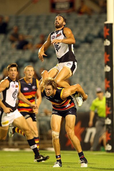Andrew Walker of Carlton goes high for a mark over Sam Shaw of Adelaide during the round three NAB Cup AFL match between the Adelaide Crows and the Carlton Blues at AAMI Stadium on March 8, 2013 in Adelaide, Australia.
