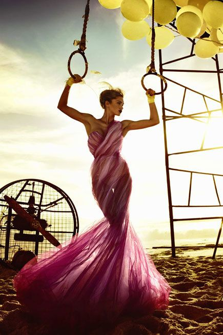 GNTM Kristian Schuller in a sheer tulle one shoulder sweetheart neck mermaid gown in shades of candy pink.
