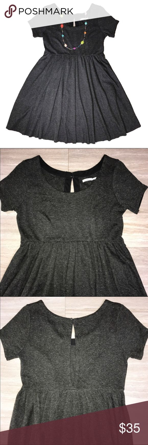 Urban Outfitters Tshirt Dress Heather Gray Large Urban Outfitters, Kimchi Blue dark heathered gray short sleeve midi tshirt dress. Fit and flare, fitted at top, flared at skirt, long keyhole back. No zipper, slip on, small hook at back neck. Acrylic/wool blend, heavier weight tee fabric, soft and comfortable. Great condition. Urban Outfitters Dresses Midi