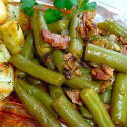 This recipe uses canned French cut green beans, combined with fresh bacon, mushrooms, and garlic for a tasty side dish.