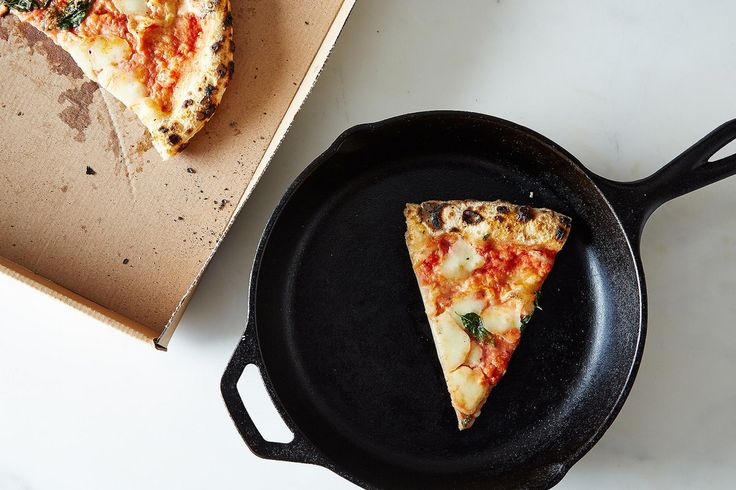 The best way to reheat pizza? Use a skillet. Place your slice in a non-stick skillet on medium-low for a couple minutes. Once the bottom is crisp, add a couple drops of water to the pan, turn the heat to low, and cover with a lid. In about a minute, you'll have fluffy crust and melted cheese.