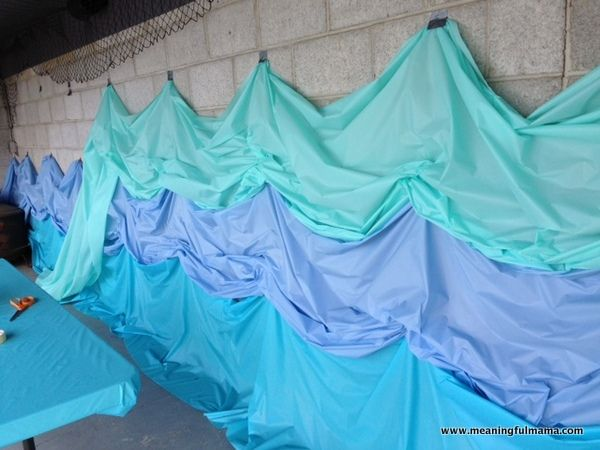 great backdrop idea! Plastic tablecloths! great for Noah's ark or some other ocean or lake themed story.