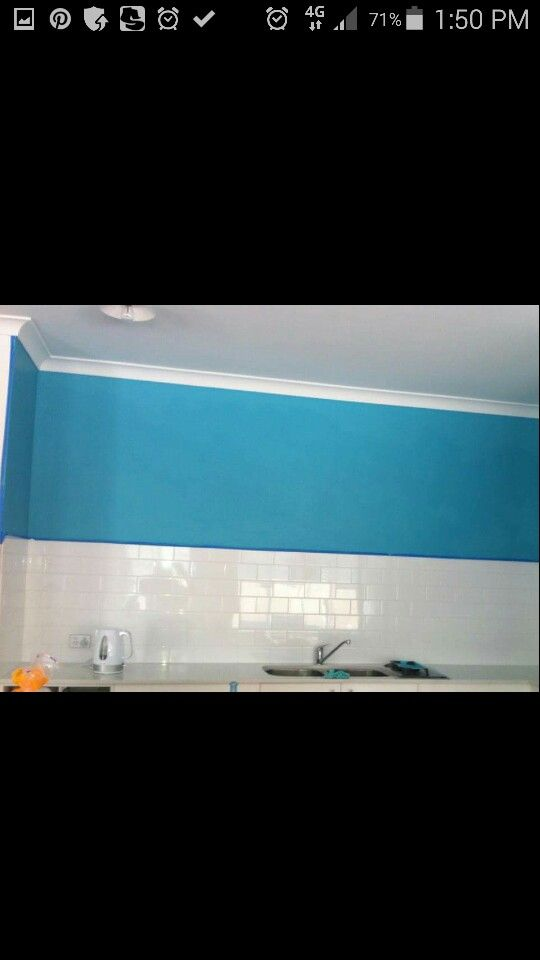 The one wall painted blue in the living,kitchen area just makes this area pop