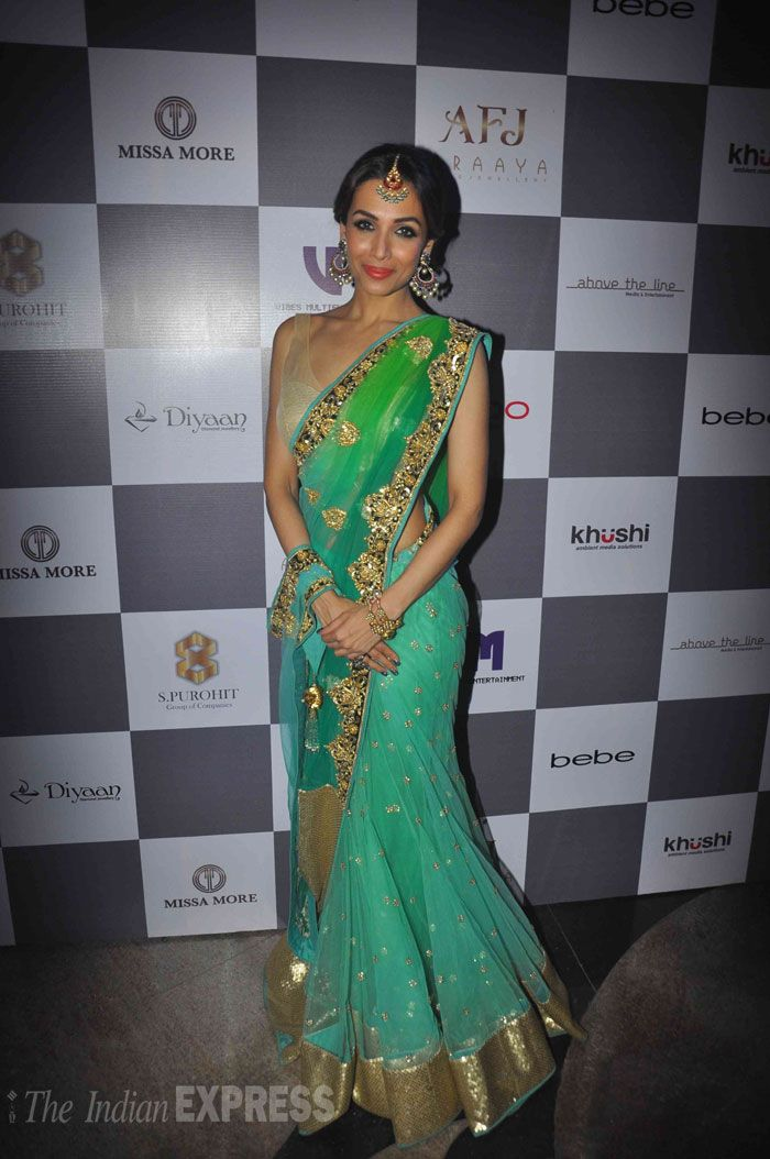 Malaika Arora Khan looked every bit of a style diva in a green sari at Madame Style Week 2014. #Bollywood #Fashion #Style #Beauty #MSW2014