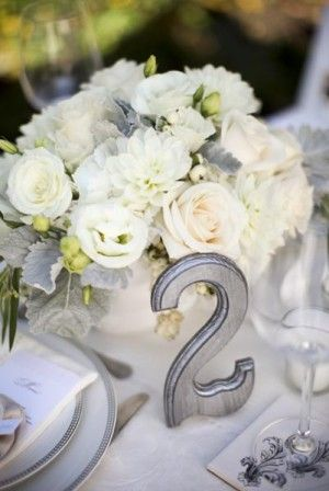 Simple and elegant. I never thought of painting wood numbers into wedding colors...
