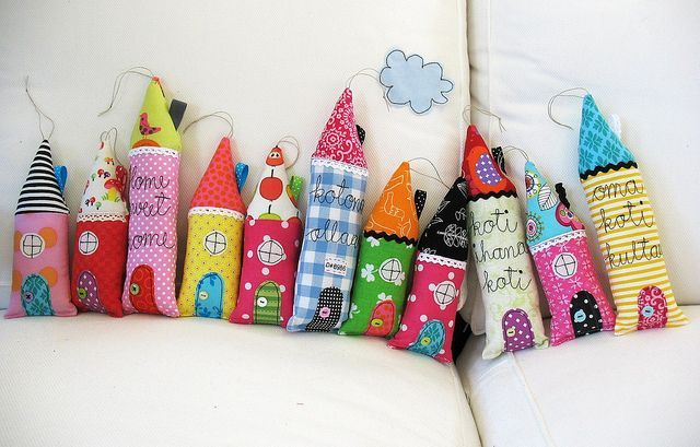 whimsical little houses. great way to use scrap fabrics.