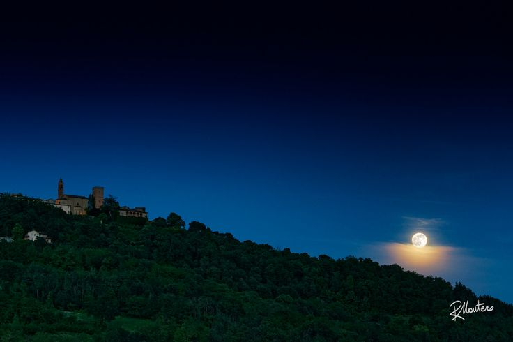 Moon over Riva  SUPPORT MY WORK! Just LIKE my Facebook page! Thanks! The full moon, over a layer of clouds, rises over Rivanazzano Hill, behind the castle, just in front of my home. A Curious phenomenon.  For more photos follow me on instagram @riccardo_mantero