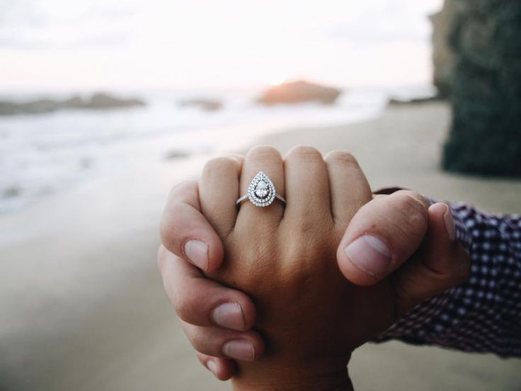 A pear shaped engagement ring with a double halo! This is the definition of glam.