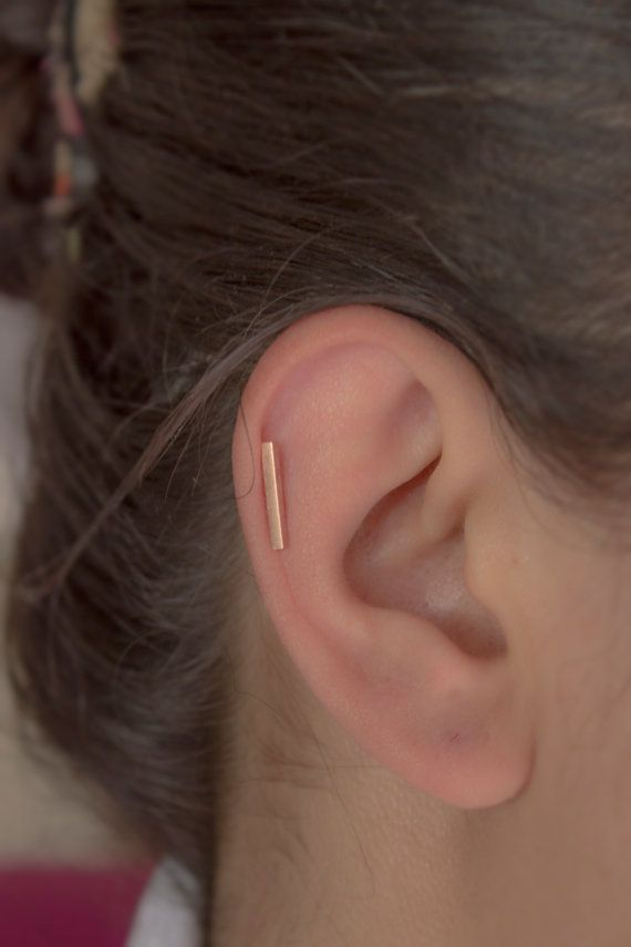 love this helix bar, perfect length and placement especially because this girl's conch fold is so slight and barely present