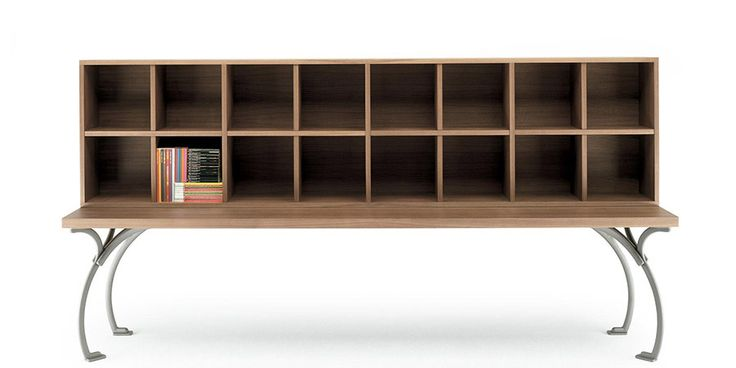 This furnishing system (table-desk-bookcase) is so essential as to be almost austere. Specially designed to provide a welcoming environment in which to converse or meet in various different situations. Characterised by the incredible combination of decorative lightness and structural weight. The table and bookshelves are made from thick multilayer wood, supported by slim cast iron legs held in place by the top. Black walnut finishing, that can also be painted bordeaux red for the table. ...