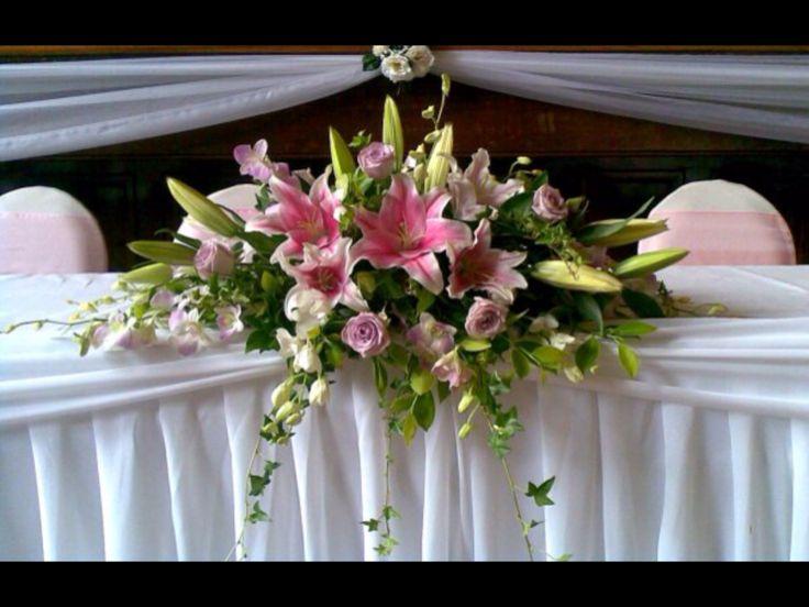 Elegant bridal table arrangement by www.newminsterfunctiondesign.com