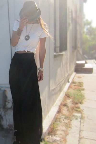 Black maxi skirt, white tie side t shirt and trilby hat. A