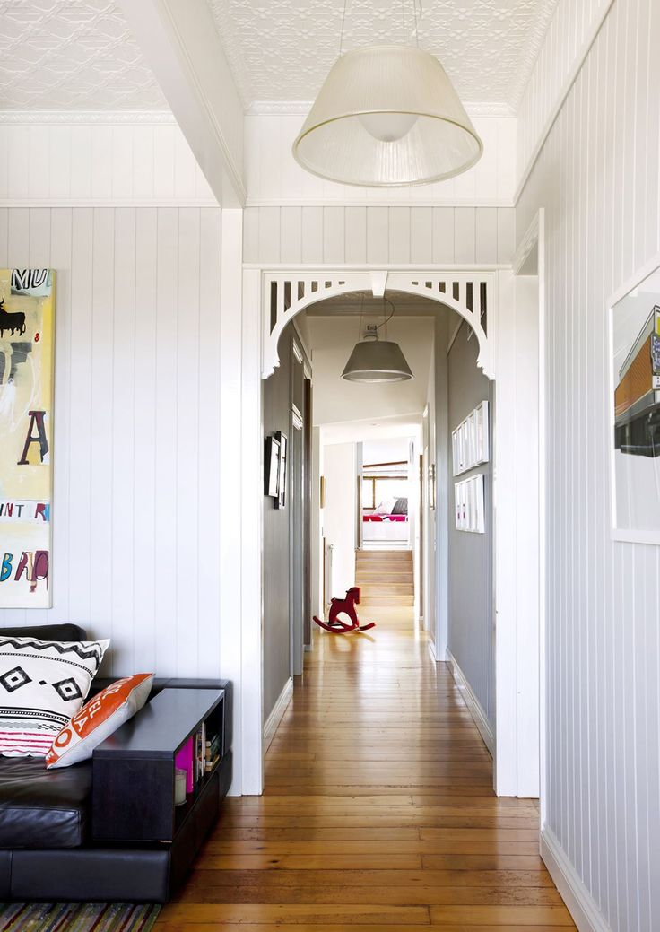 "The original parts of the house feature pressed-metal ceilings, including in this upstairs living area. Jasper **sofa** in Viva Mocha leather from [King Living](http://www.kingliving.com.au/|target=""_blank""). **ABOVE SOFA** **artwork** by Adam Lester. **RIGHT** **artwork** by Ward Squires. VJ **laminated sheeting** on walls from [CGH Constructions](http://cghconstructions.com.au/