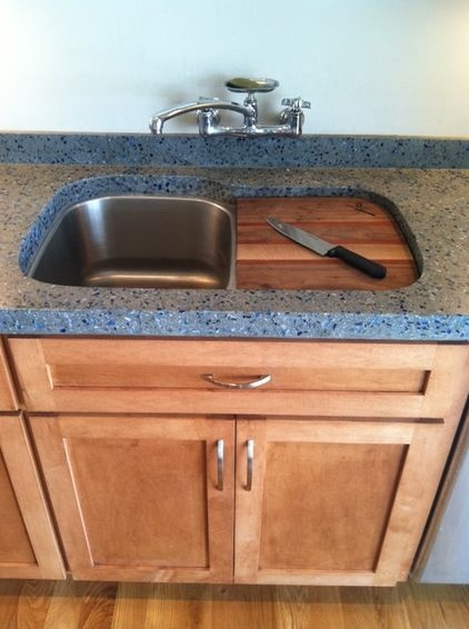 A cutting board over the garbage disposal. This is a perfect example of a clever design solution that saves time and effort.
