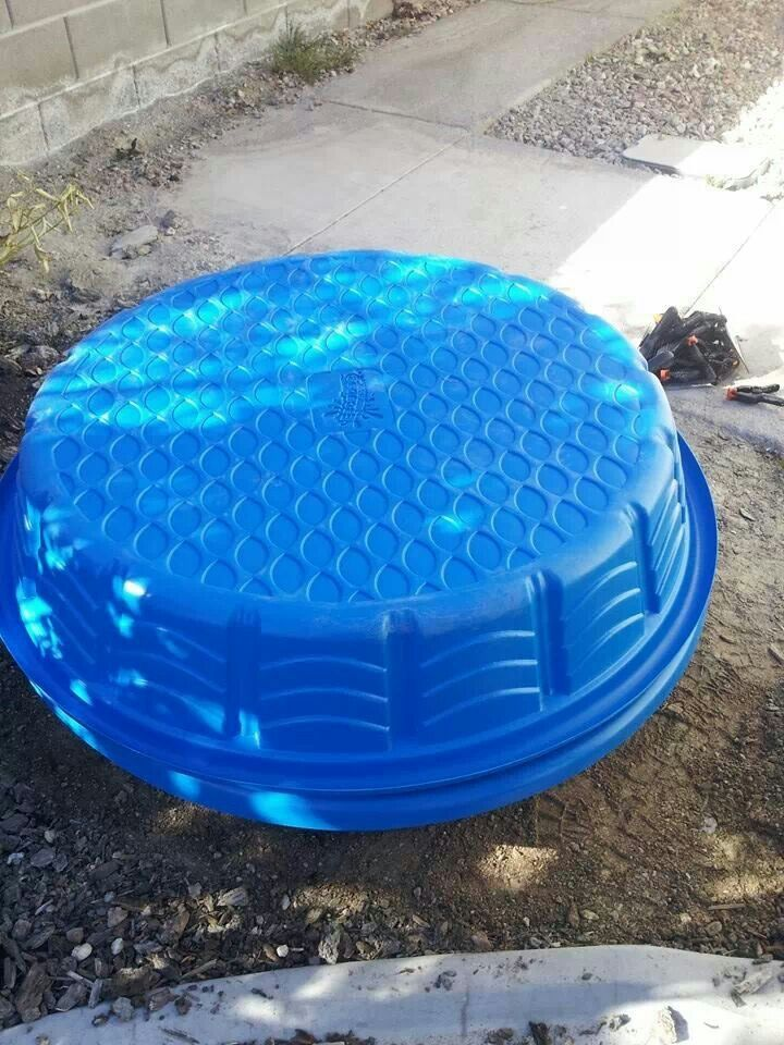 Kid pool covered and clamps hold cover on. Filled with sand for sandbox.