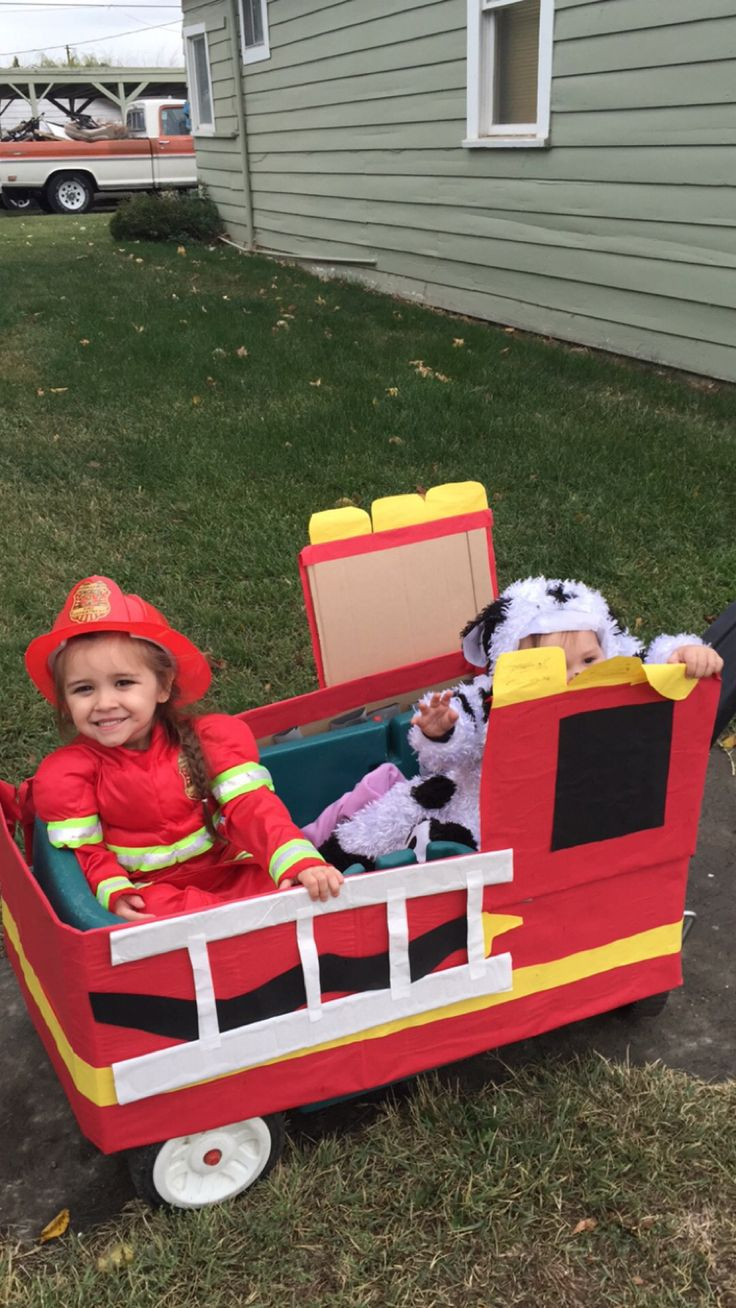 DIY Firetruck wagon for Halloween. Cardboard, butcher paper, mod podge, and gorilla tape