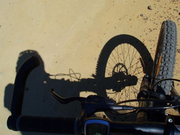 a riders eye view of a bike ride along a dirt trail - free stock photo from www.freeimages.co.uk