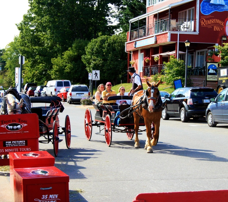 Carriage Ride in Lunenburg, Nova Scotia -  The Town of Lunenburg, in Nova Scotia, Canada, was formally established in 1753 as the first British Colonial settlement in Nova Scotia outside of Halifax. These early settlers were from various parts of Germany, Switzerland, and the Montbeliard region of France. Image By Rediscovering Canada