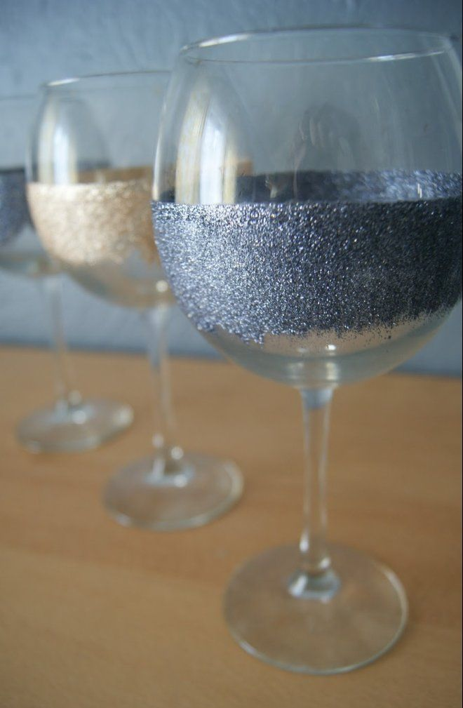 What You'll Need:  Plain stemware  Glitter  Painter's tape  Modge Podge  Paint brush  How To Make It:  1. Make sure your glasses are clean and dry. Wrap a piece of painter's tape around the the rim of each glass.  2. Use a paint brush to apply Modge Podge around the glass, painting in downward strokes.  3. Sprinkle glitter so that it sticks to the Modge Podge.  4. Apply another coat of Modge Podge over the glitter to seal it in place.