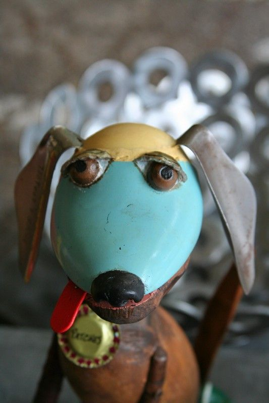 Dog named patches...assemblage art. Made from recycled materials.